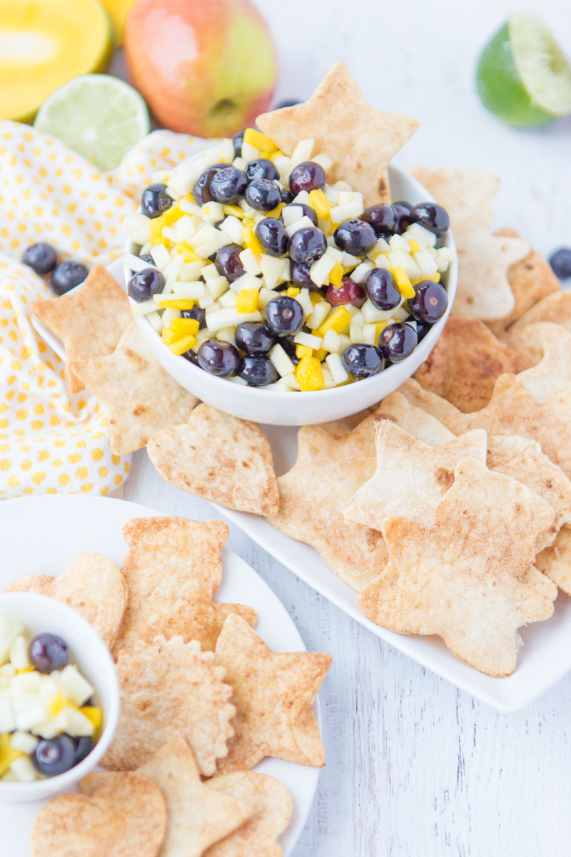 Cinnamon Sugar Tortilla Chips: a delicious and quick snack perfect to serve with a fresh fruit salsa.  Use different shaped cookie cutters to make this a fun snack for the kids!