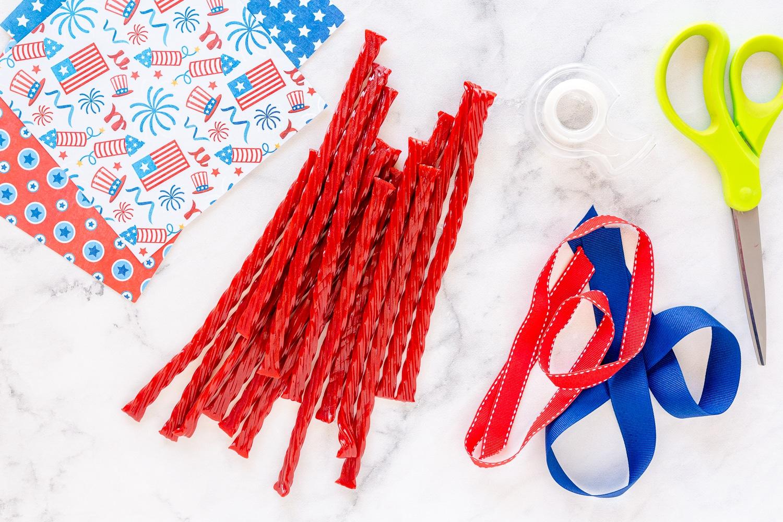 supplies needed: twizzlers, tape, ribbon, scissors