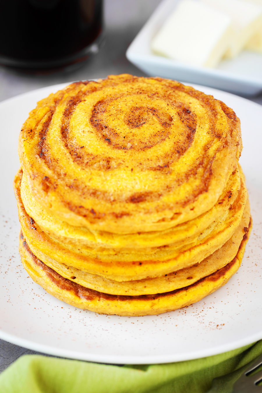 These Pumpkin Cinnamon Swirl Pancakes are filled with a cinnamon sugar swirl and delicious fall flavors!