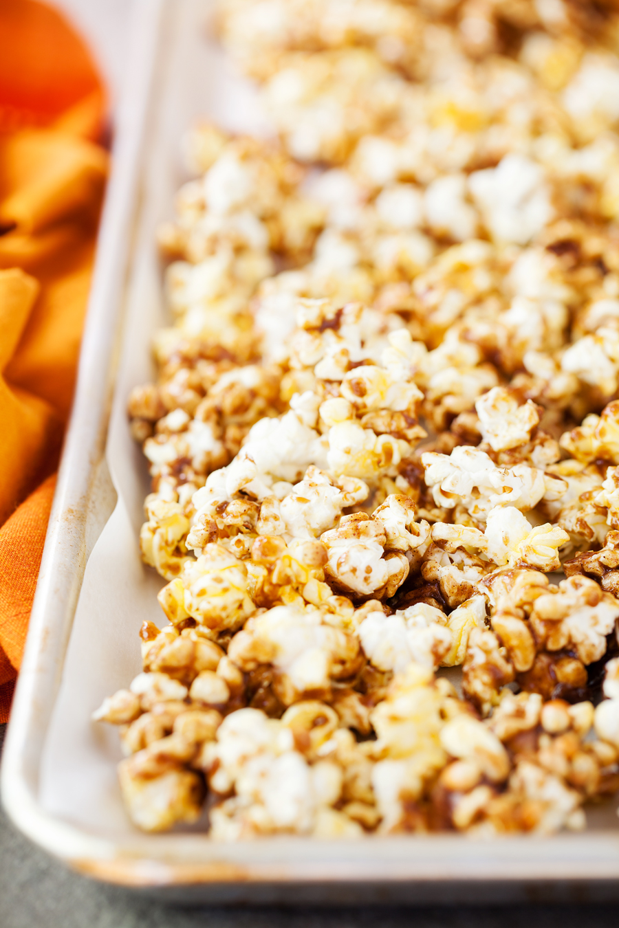 This Pumpkin Spice Caramel Popcorn is simple and bursting with fall flavors! It's the perfect amount for parties and to share with a friend!