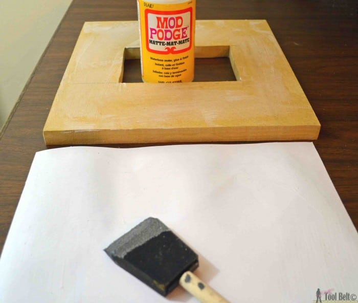 Create an awesome custom gallery wall with these DIY stacked picture frames.  Free woodworking plans