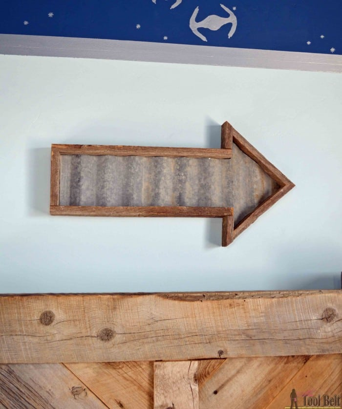 Make an easy DIY rustic arrow with free plans.  Add tin in the center for an industrial feel.