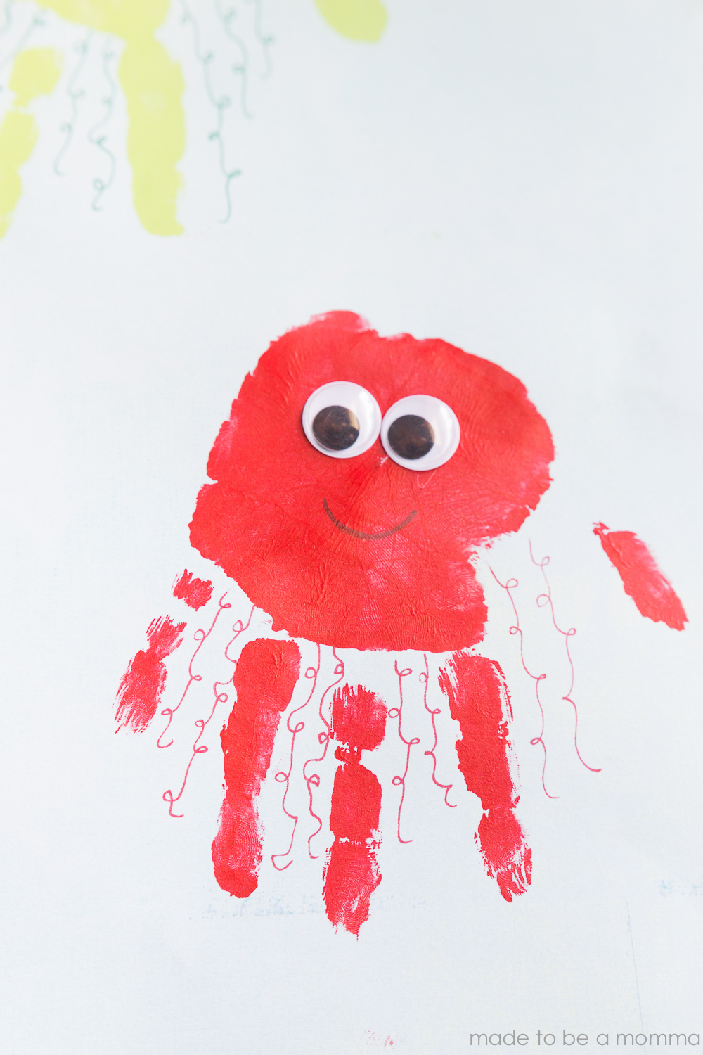 Kids Handprint Jellyfish Art: celebrate summer with this fun handprint kids craft!