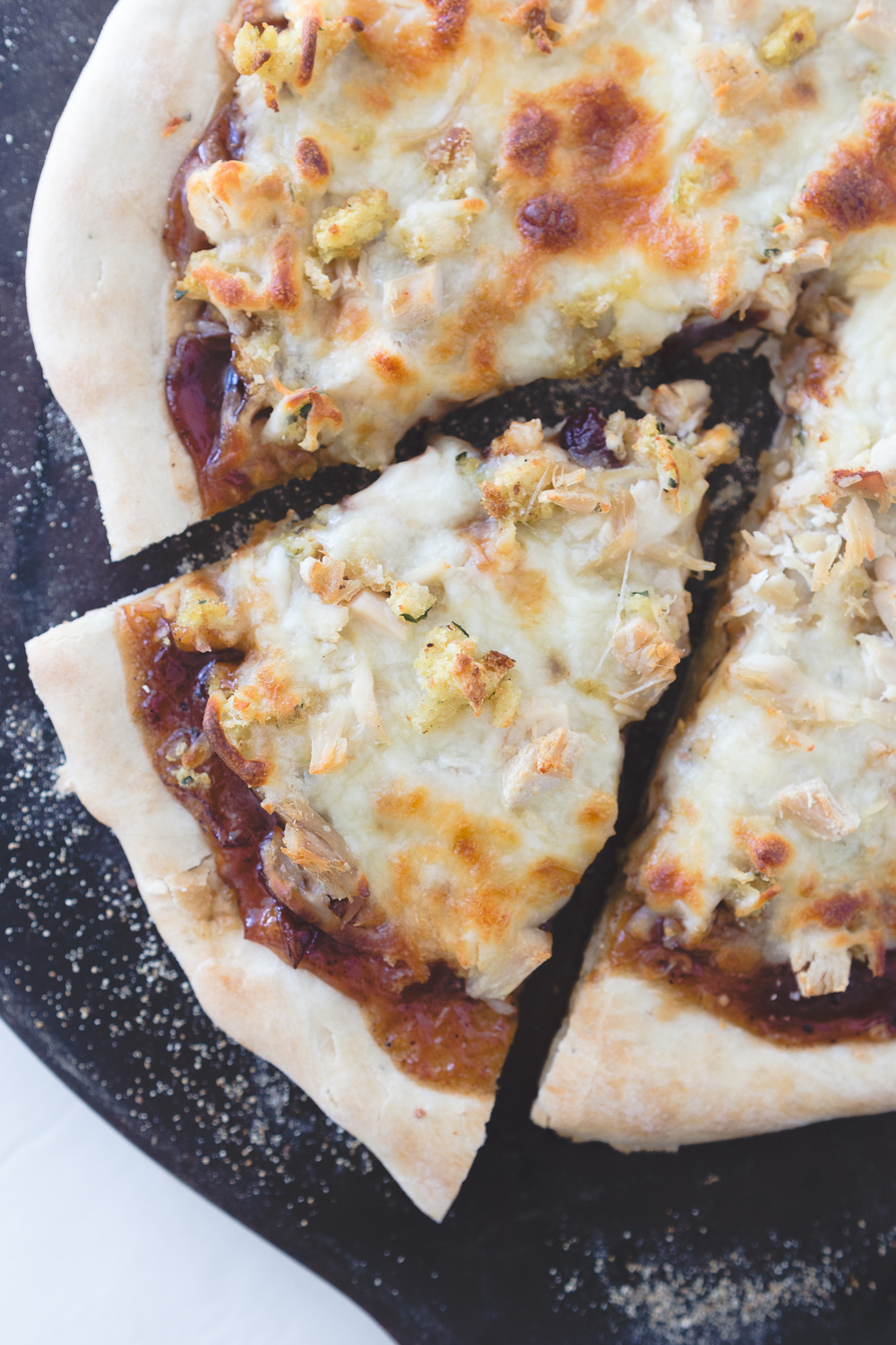 Thanksgiving Leftovers Pizza: Thanksgiving left overs turkey, stuffing and cranberry sauce come together in a fun new pizza recipe!