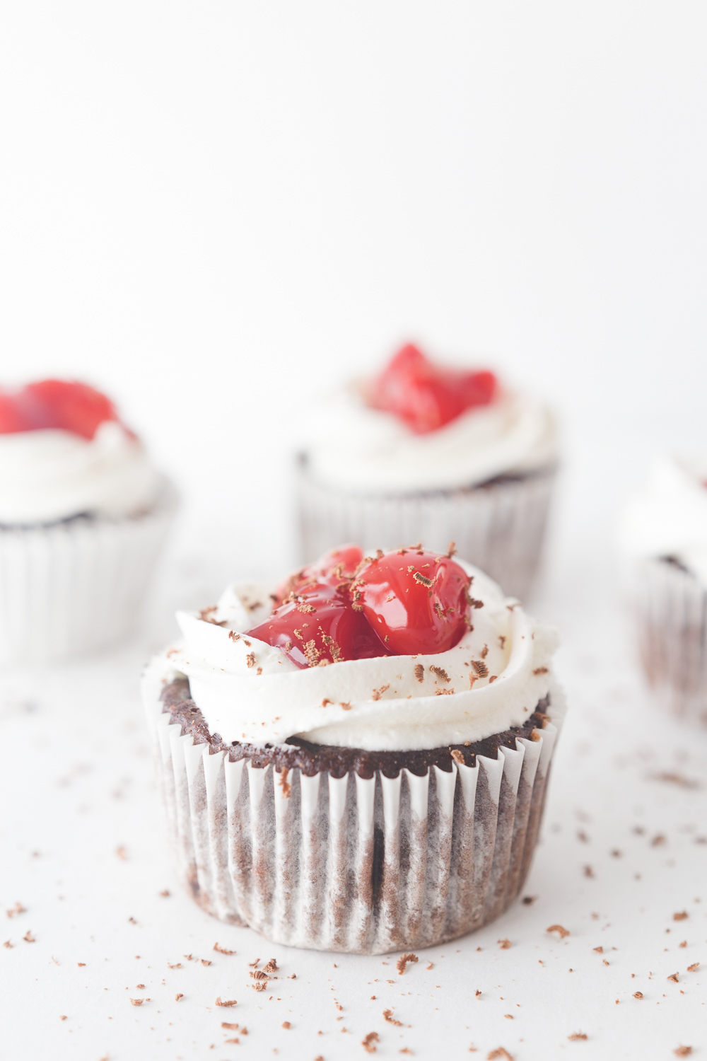 Black Forest Cupcakes: these chocolate cupcakes are stuffed and topped with cherry pie filling and a delicious cream cheese frosting. Great for holiday parties and everyday gatherings.