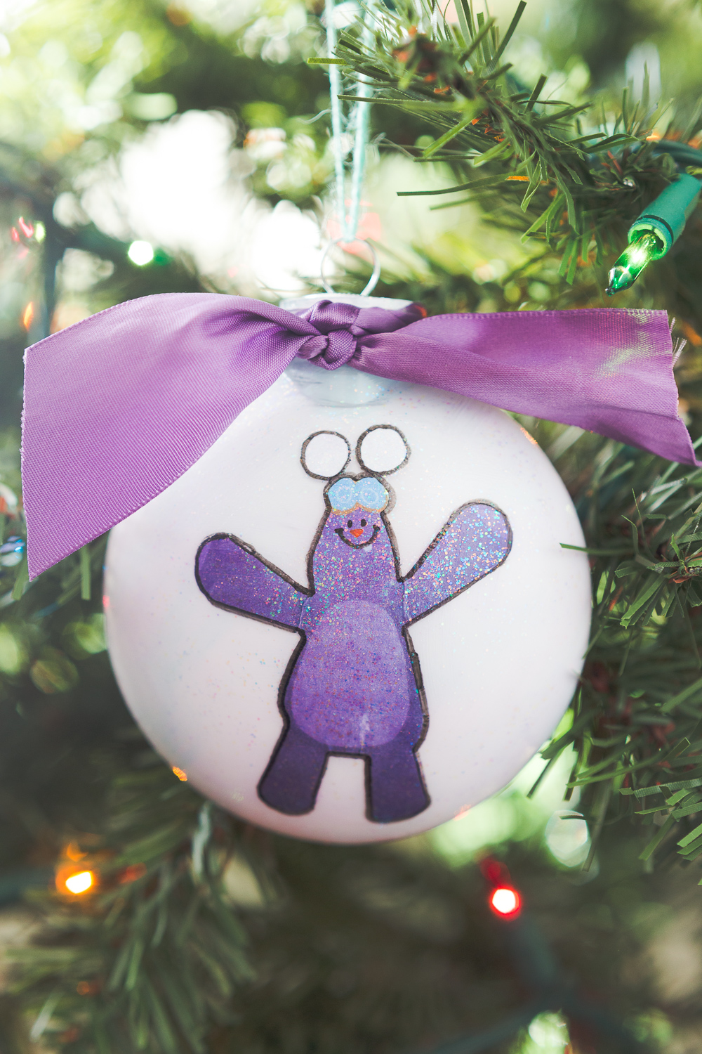 This Mim Mim Ornament is perfect for any Kate and Mim Mim fan!  Tied with a purple bow and some sparkle this is an ornament your kids will really enjoy making!