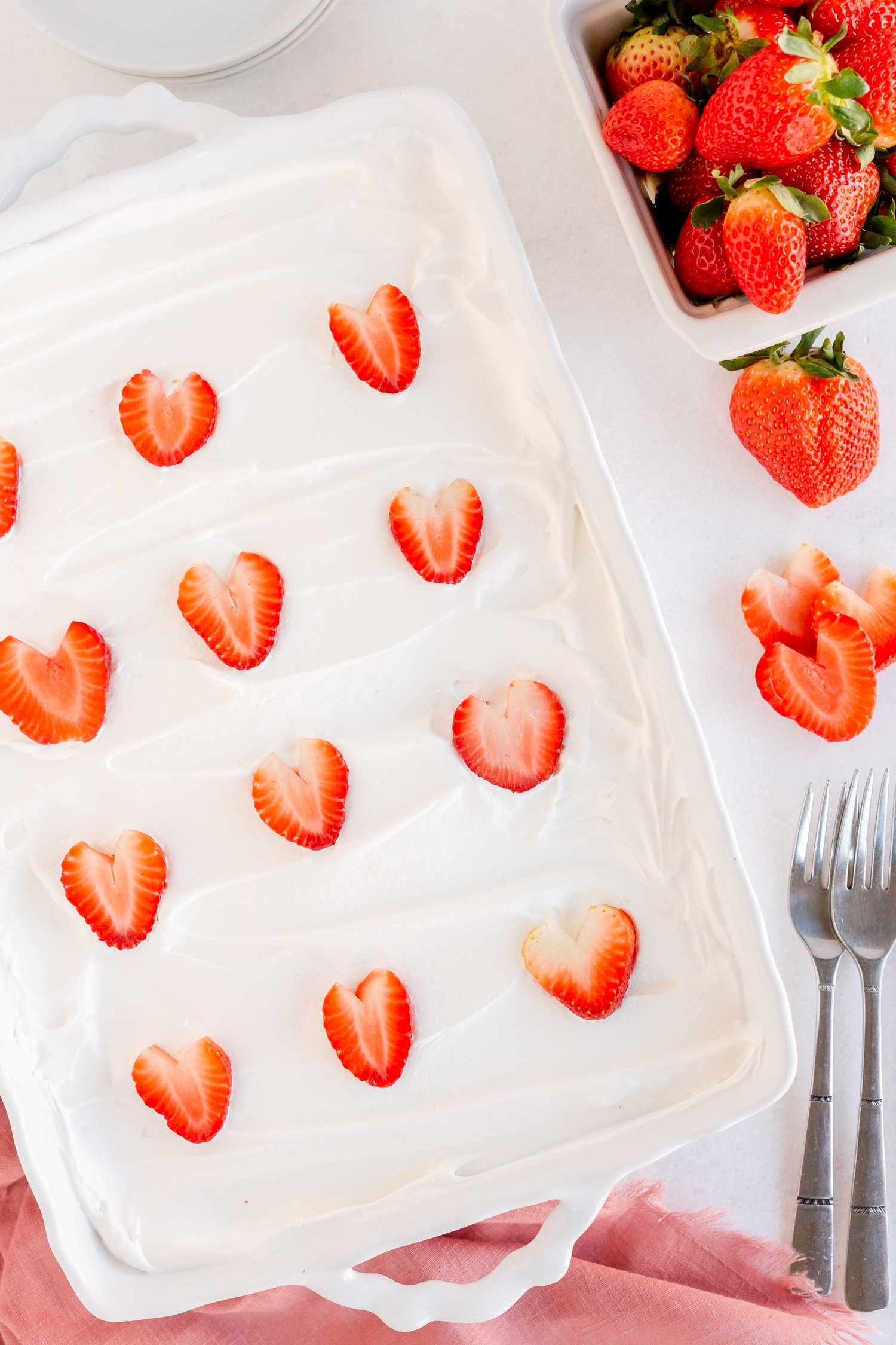 cake mix with sliced strawberries on top