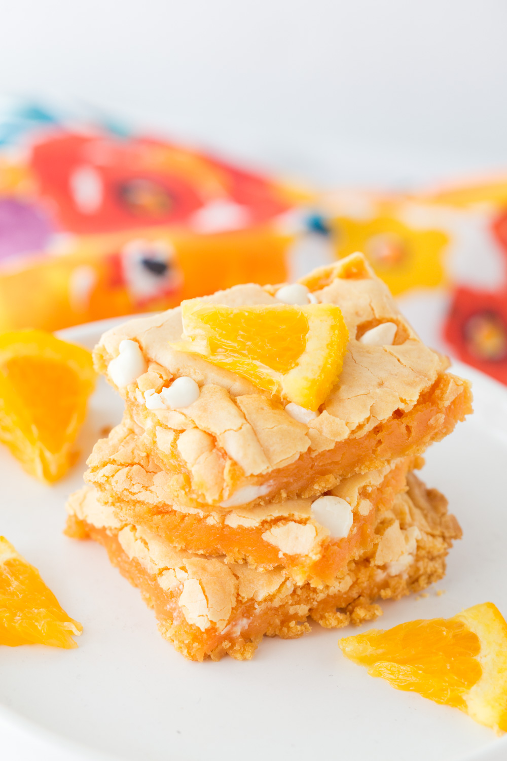 Orange Creamsicle Cake Mix Bars are delicious and bursting with an orange flavor. The white chocolate chips adds the perfect bite of creaminess!