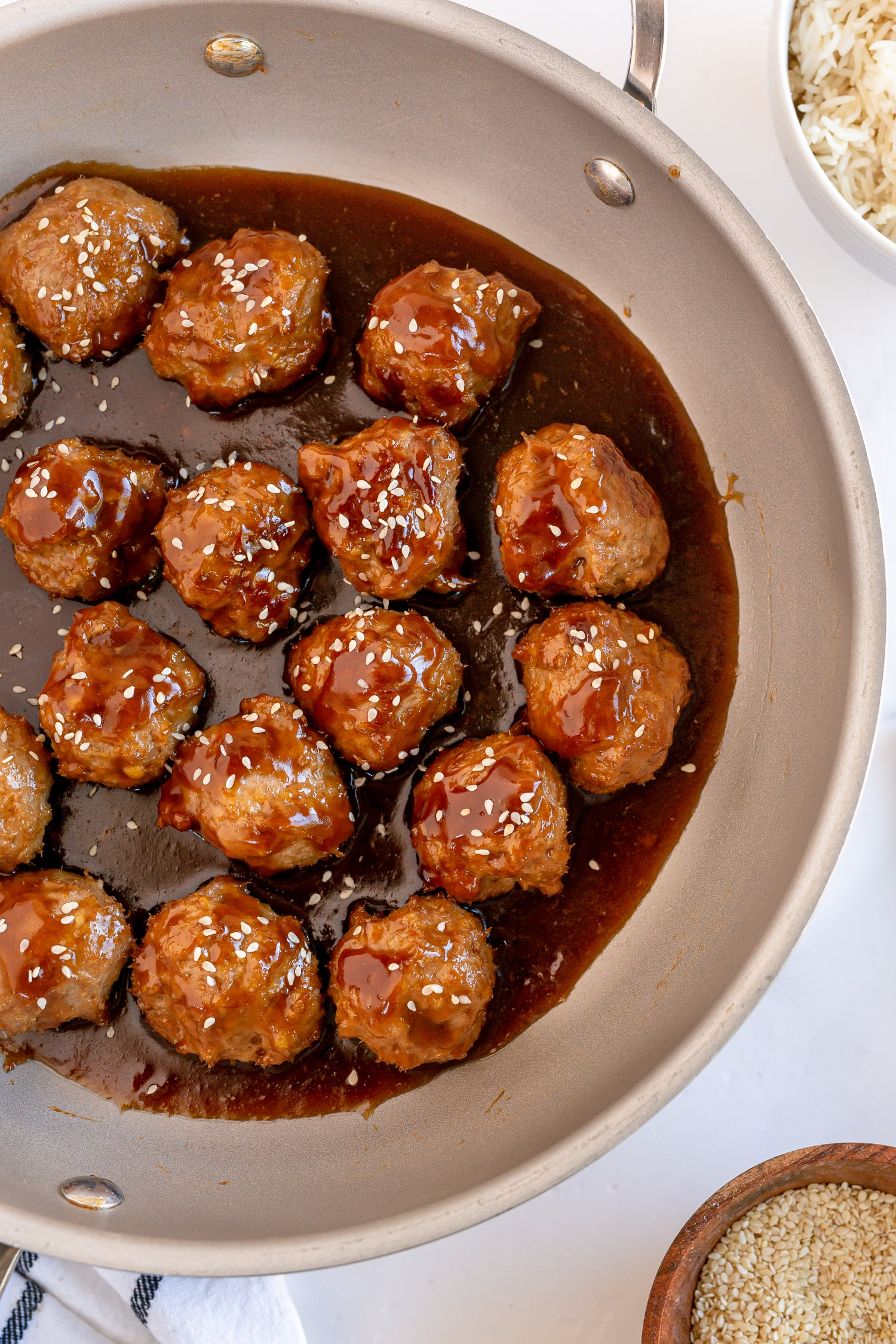 teriyaki turkey meatballs in saucepan with teriyaki sauce