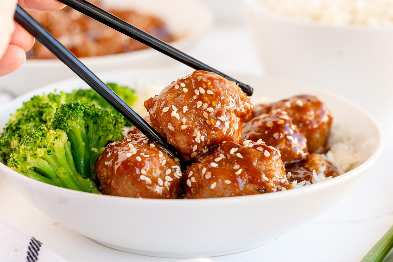 turkey meatball in bowl with chopsticks