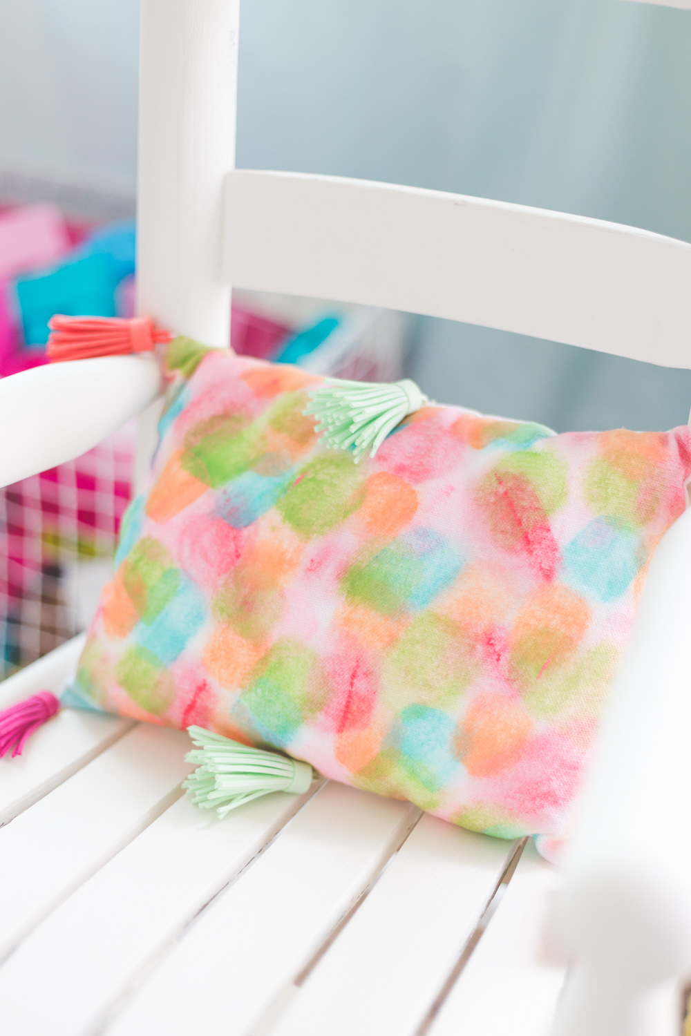 This Paint Stroke Watercolor Pillow is such a fun and easy diy that is a pop of color in any kids room!