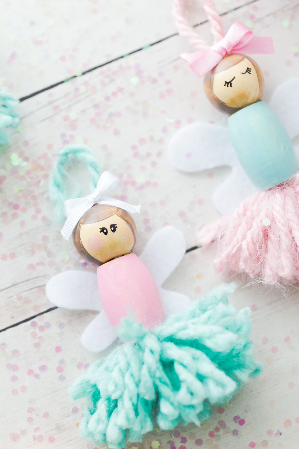 These Pom Pom Ballerina Fairies are the sweetest project for any little girl! They make great little bookshelf decorations or ornaments.