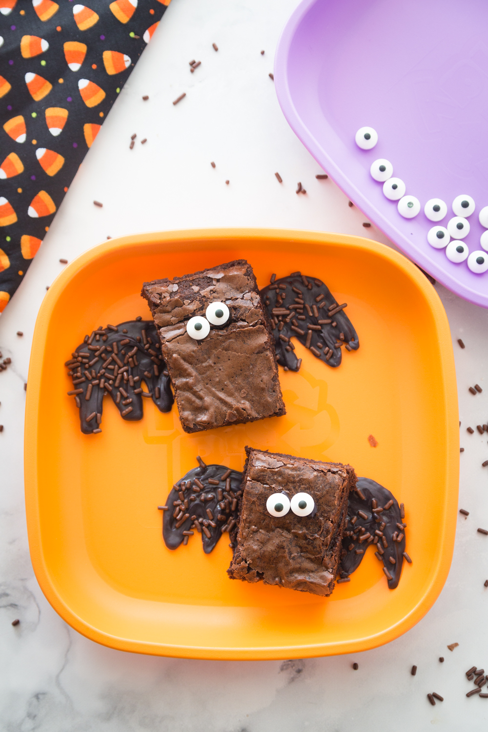 These Halloween Brownie Bats are a delicious Halloween treat the kids will love! Brownie Mix, googly eyes and sprinkles make them a boo-tastic treat!