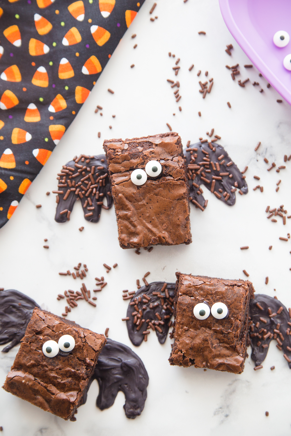 these halloween brownie bats are a delicious halloween treat the kids will love brownie mix googly eyes and sprinkles make them a boo tastic treat