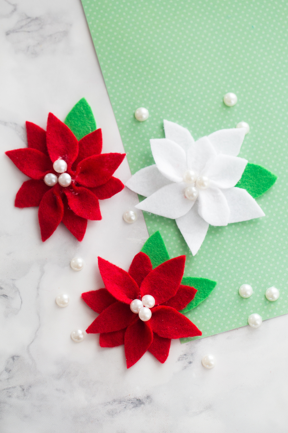 DIY Felt Poinsettia Decorations | 50 Awesome DIY Yule Decorations and Craft Ideas You Can Make for the Winter Solstice