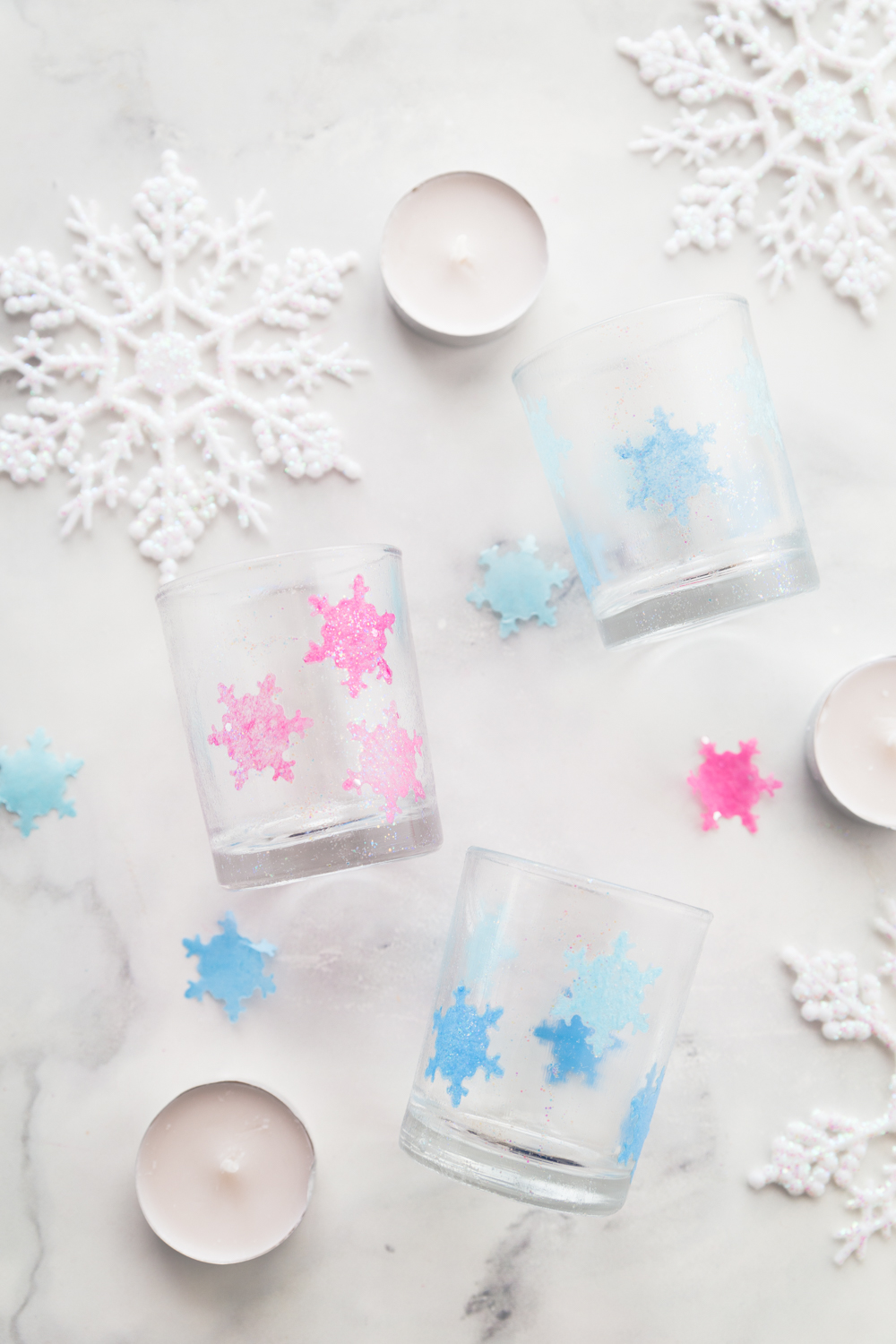 These Tissue Paper Snowflake Luminaries are a perfect and simple holiday craft.