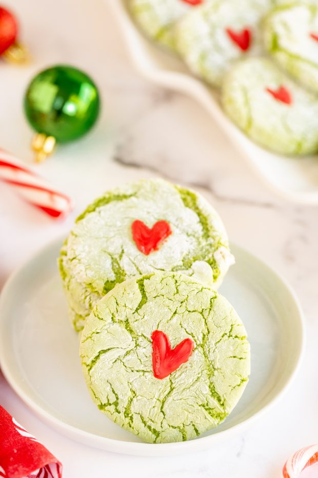 grinch cookies on white plate