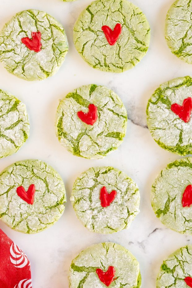 Grinch Cookies on Table with Red Hearts