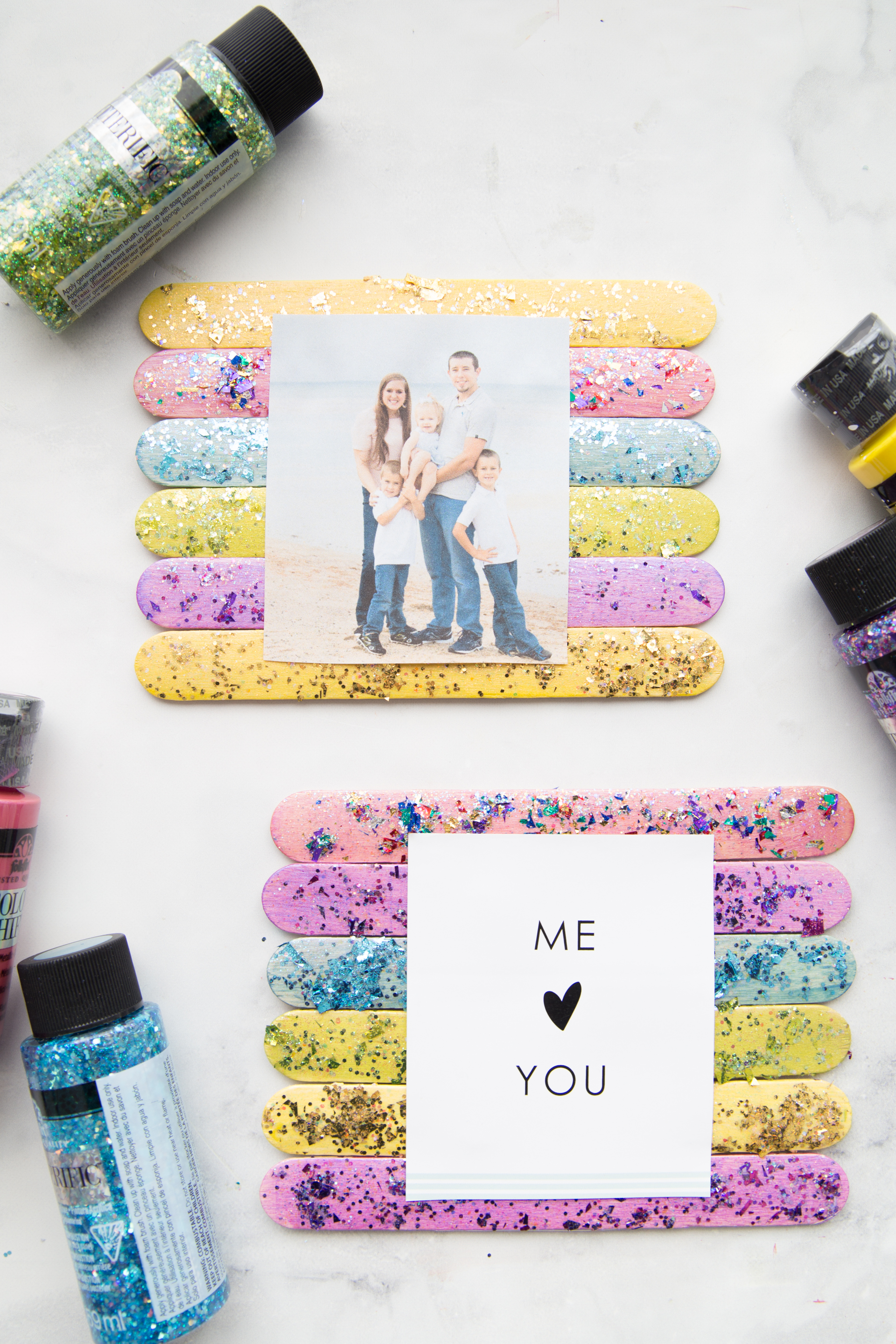 Glitter Popsicle Frames: a colorful and sparkly popsicle stick frame to show off some of your favorite images.