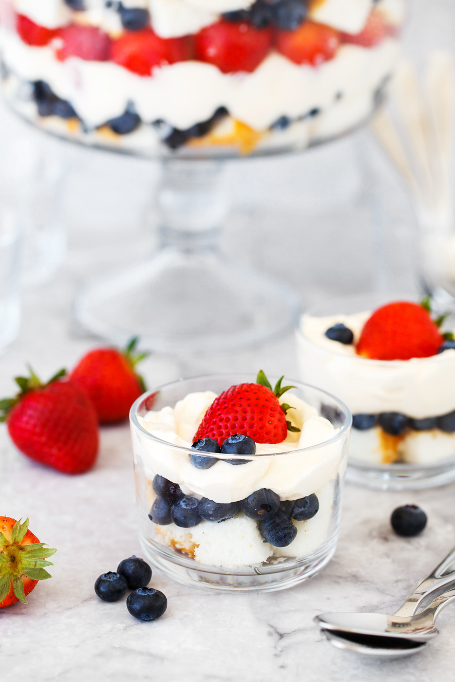 Individual servings of angel food cake berry trifle