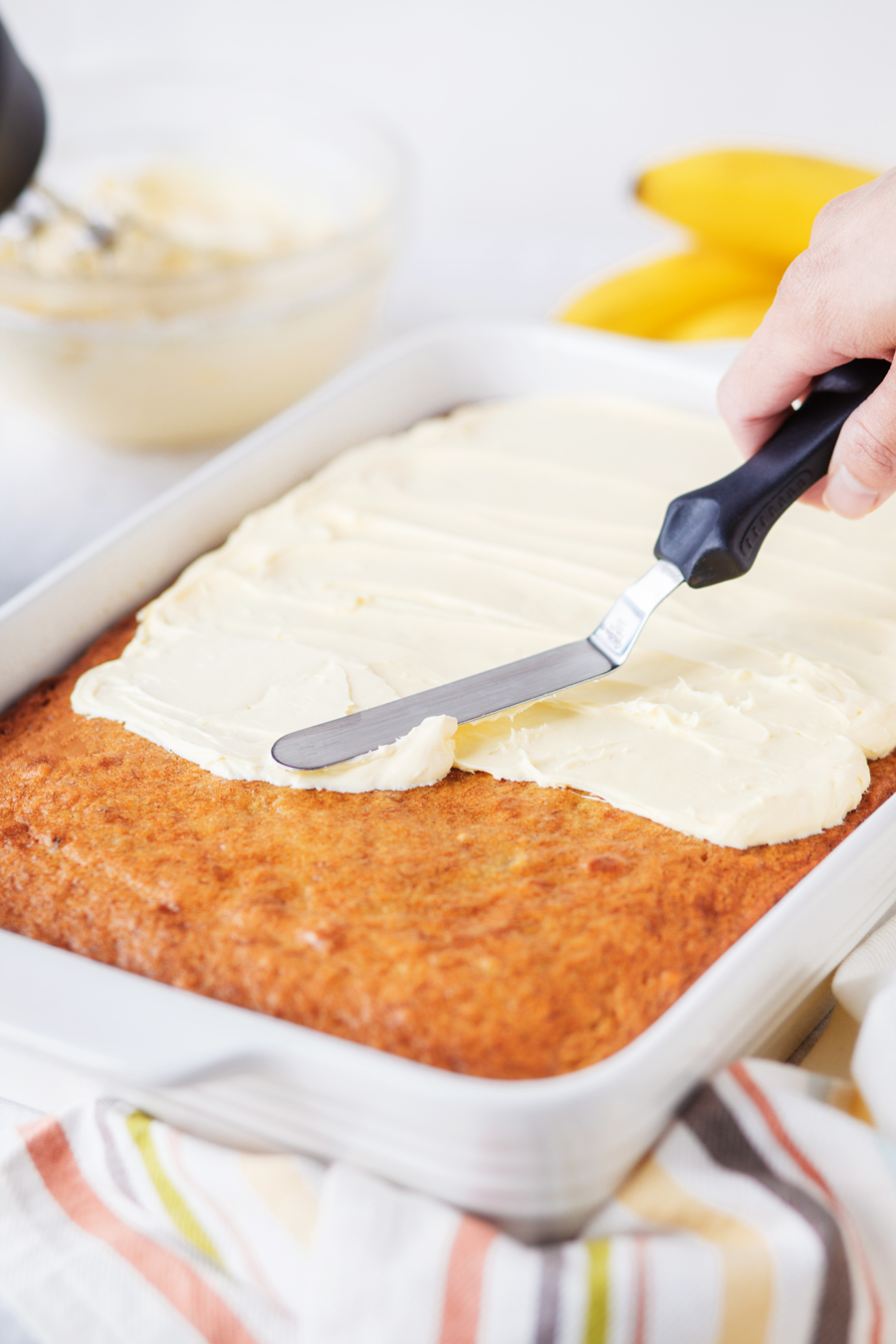 Cream Cheese Frosting being frosted on Banana Cake
