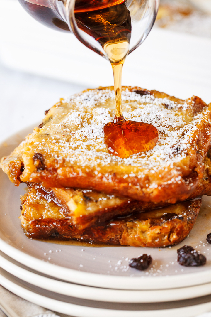 Baked Raisin French Toast: a yummy and simple overnight breakfast french toast.  Use raisin bread for a twist on the classic french bread taste. Serve with eggs and a cup of coffee for a delicious and warm breakfast!
