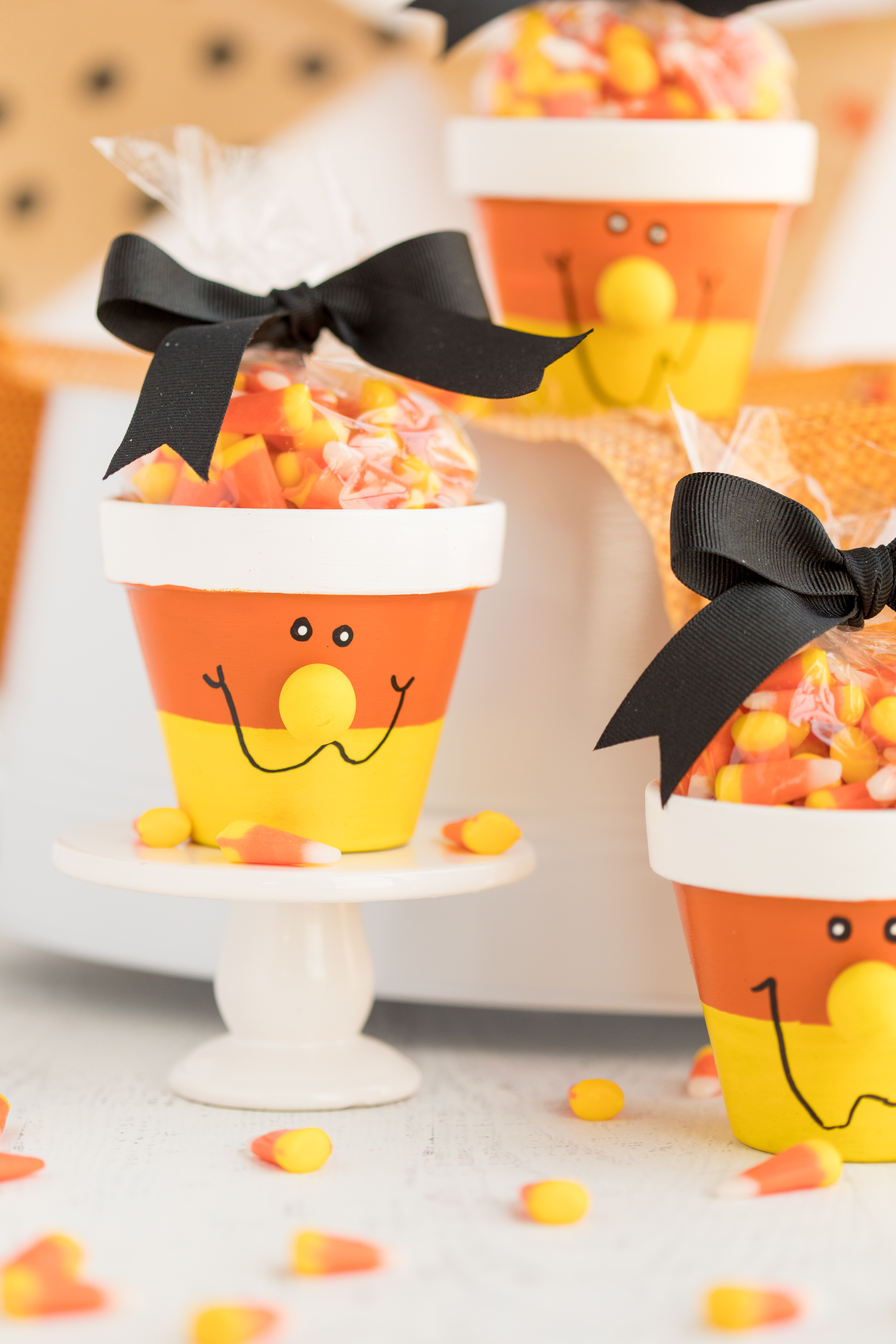 Candy Corn Candy pots displayed on cupcake holder