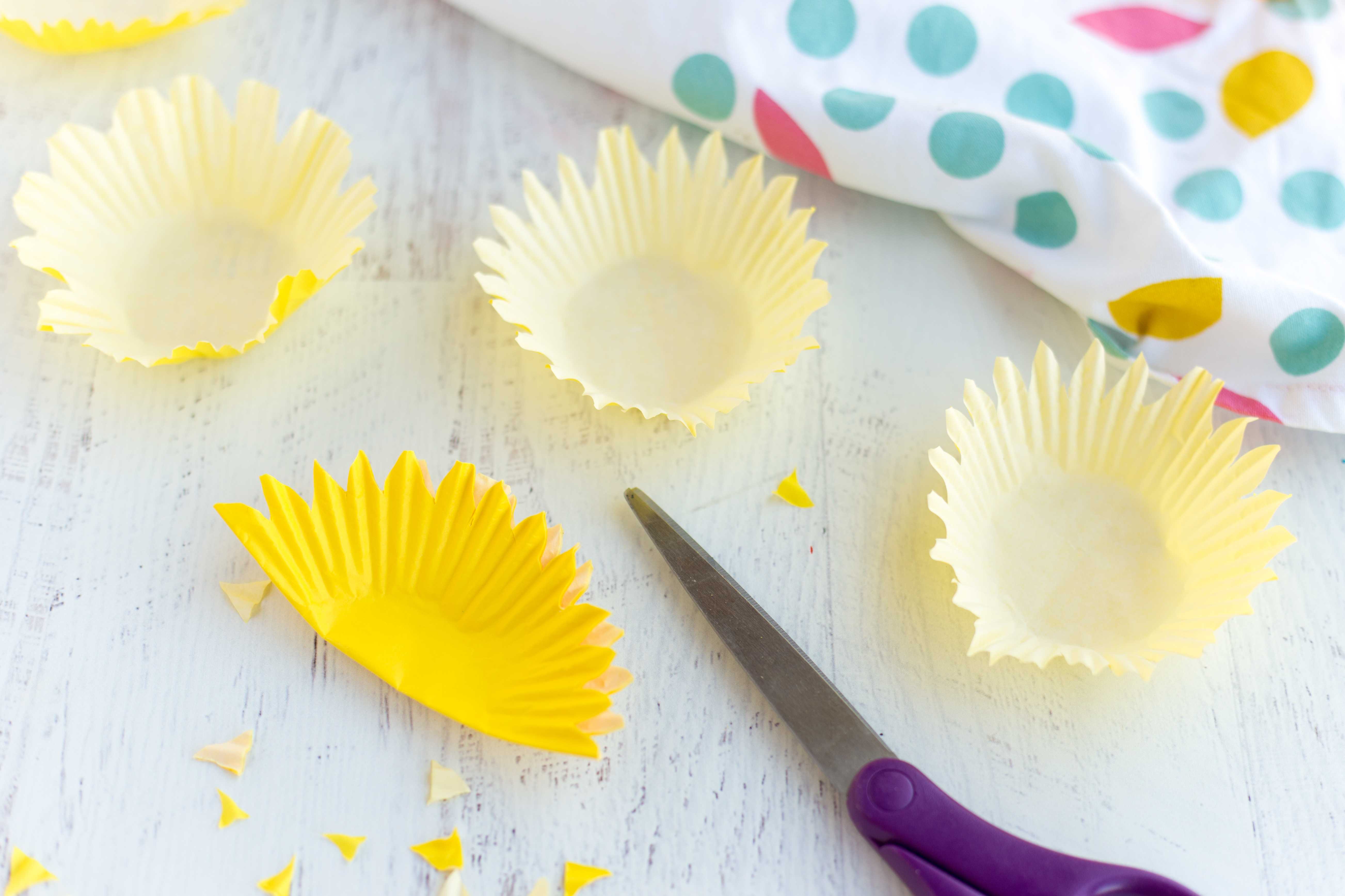 Yellow Cupcake liners into sunflower shapes