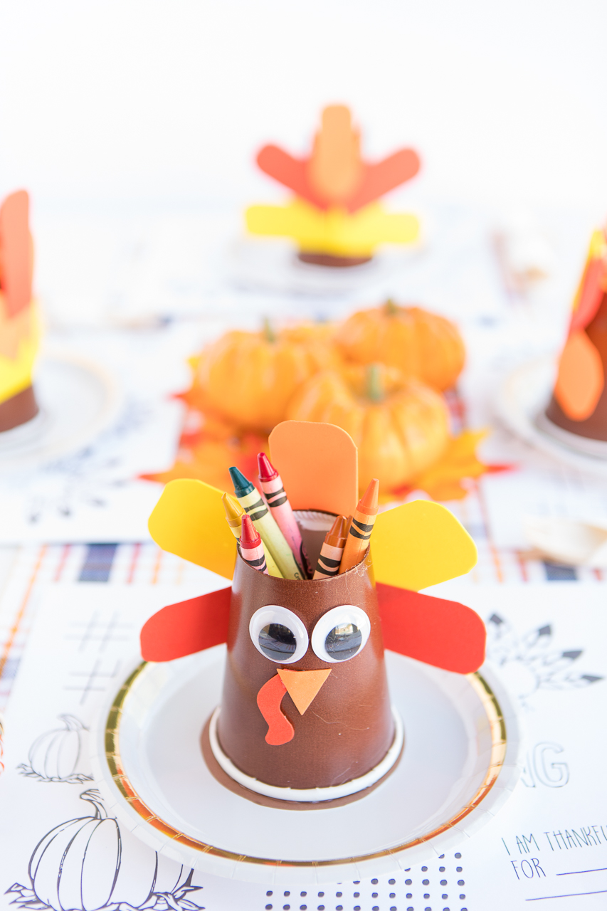 Turkey Crayon Holder: a fun and simple Thanksgiving craft that is perfect to help keep the kids busy during the day.  A bright turkey holds colorful crayons and goes great with some printable coloring and activity pages.