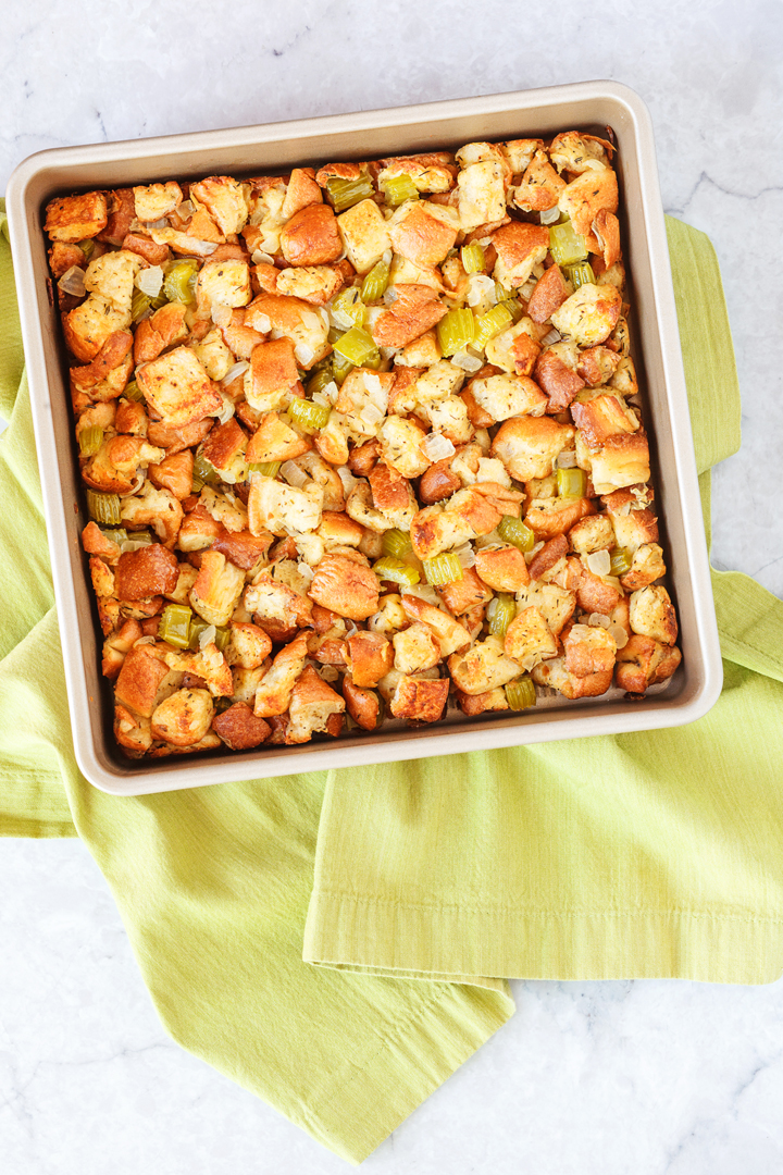 Classic Herb Stuffing Recipe: a delicious Thanksgiving stuffing recipe that is filled with bread cubes and seasonings. Baked until it has a slightly crisp topping and soft insides, great with turkey and cranberry sauce.