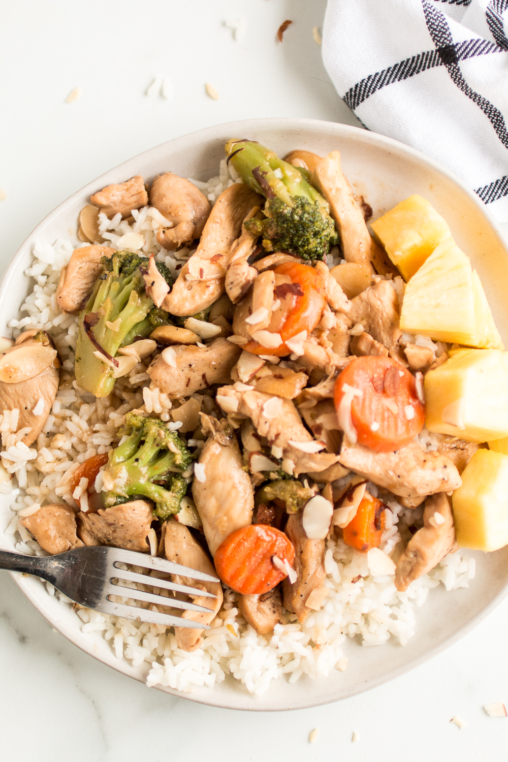 Chicken Almond Stir Fry: a delicious and quick family friendly meal filled with protein, veggies and a sweet pineapple sauce flavor!