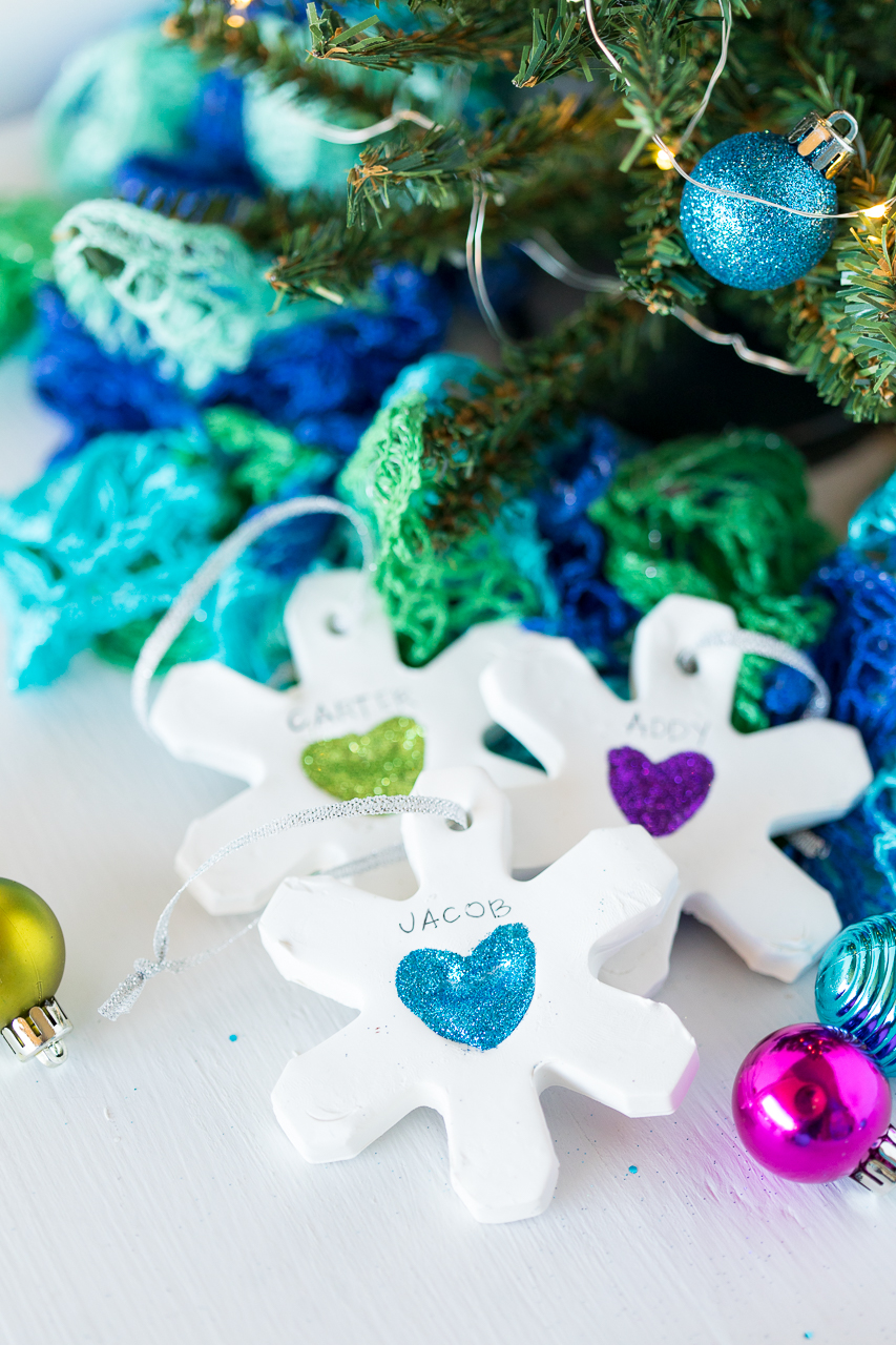 These Thumbprint Snowflake Ornaments are such a fun DIY kids ornament.  All you need is some modeling clay, glue, and glitter.
