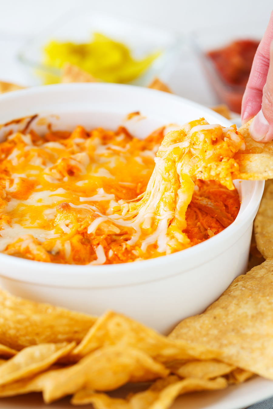Hot Wing Chicken Dip -a delicious appetizer filled with shredded chicken, hot sauce, and cheese and baked to perfection. Serve with veggies or chips at your parties.