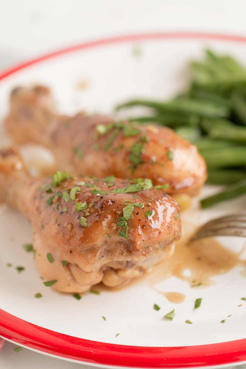 This Honey Balsamic Chicken Drumsticks recipe is a delicious and fast dinner idea you can have on your table in under 1 hour! This chicken recipe can be made in the oven or the instant pot! Serve it with buttered noodles and green beans for a delicious meal!
