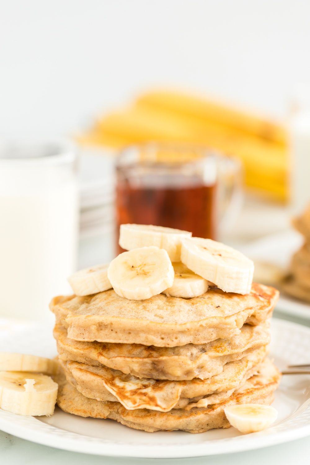 Easy Banana Pancakes a delicious fluffy banana pancake recipe that is so flavorful and perfect for breakfast when topped with syrup and fresh banana slices.