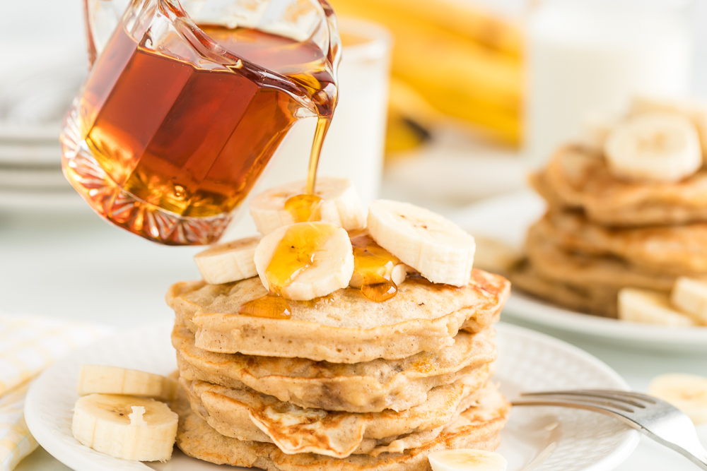 syrup poured on banana pancakes