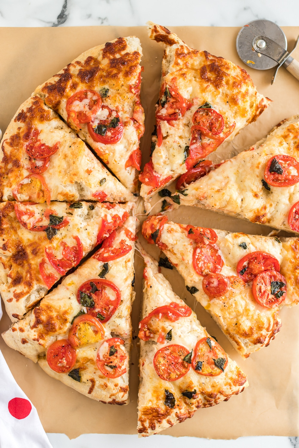 Margherita Pizza: a delicious homemade pizza full of flavor! Fresh tomatoes and basil are the key ingredients to this delicious and simple pizza recipe.