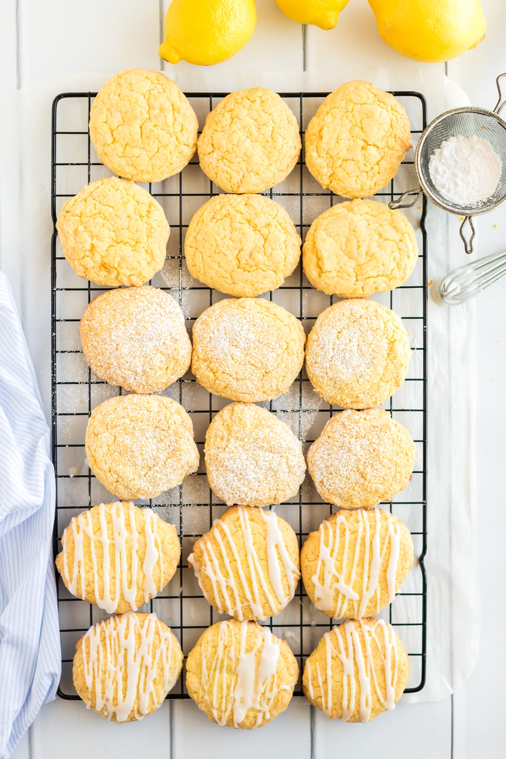 lemon cake mix cookies with icing and powdered sugar