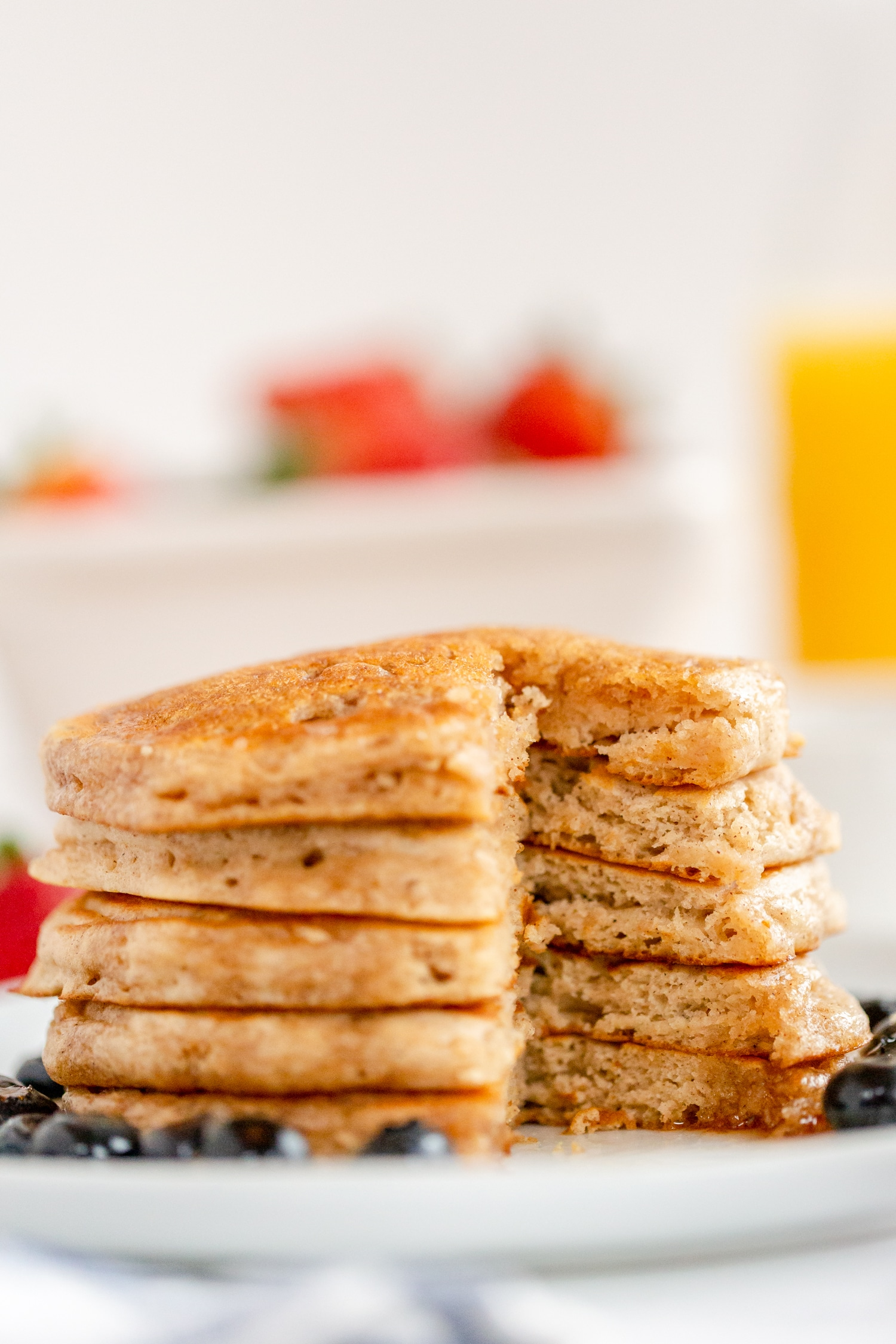 fluffy pancakes stacked on white plate