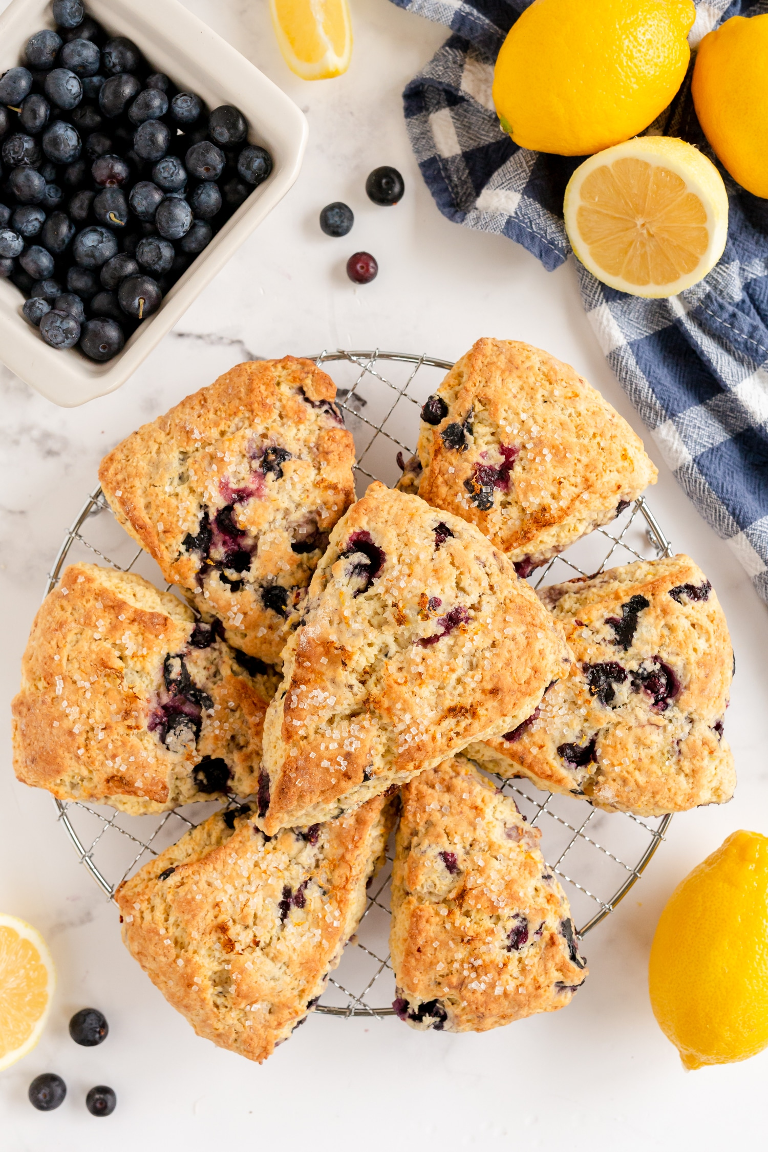 lemon blueberry scones on platter with lemons and blueberries as props