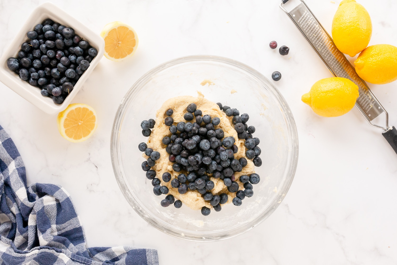 fold blueberries into batter