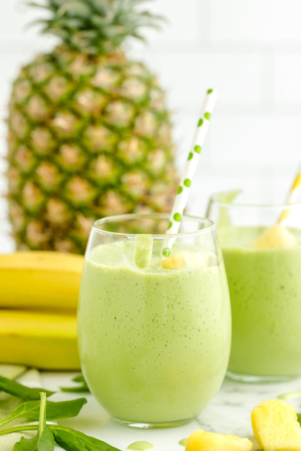 This Pineapple Green Smoothie is a delicious way to start off your morning or to enjoy anytime during the day! This green smoothie is filled with pineapple, spinach greens and loads of flavor!