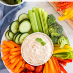 This Easy Vegetable Dip Recipe is packed with flavor and is a delicious way to eat more veggies- it's even kid approved! Serve with your favorite veggies- chips and pretzels are great too!