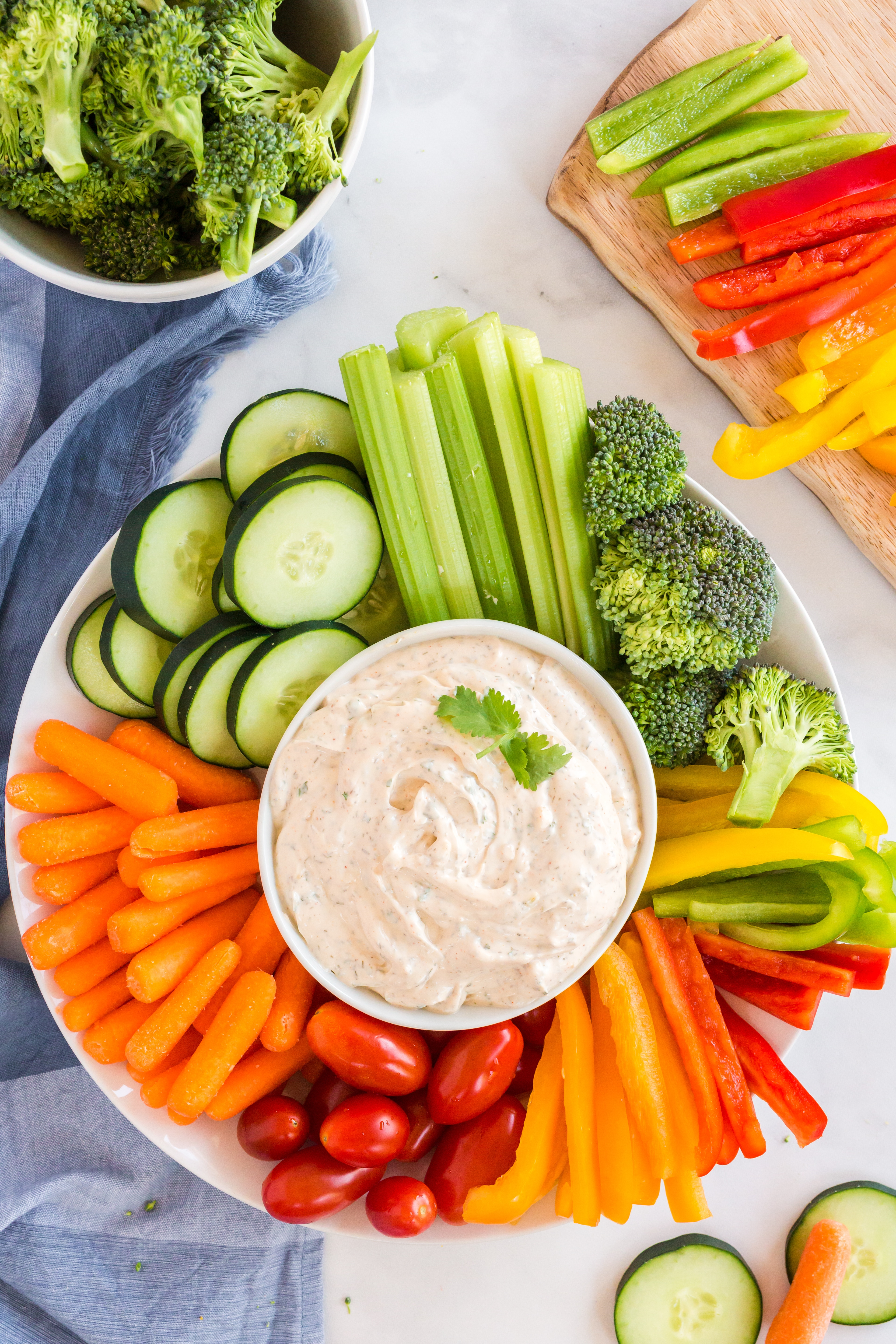 veggie plater with vegetable dip and colorful veggies around
