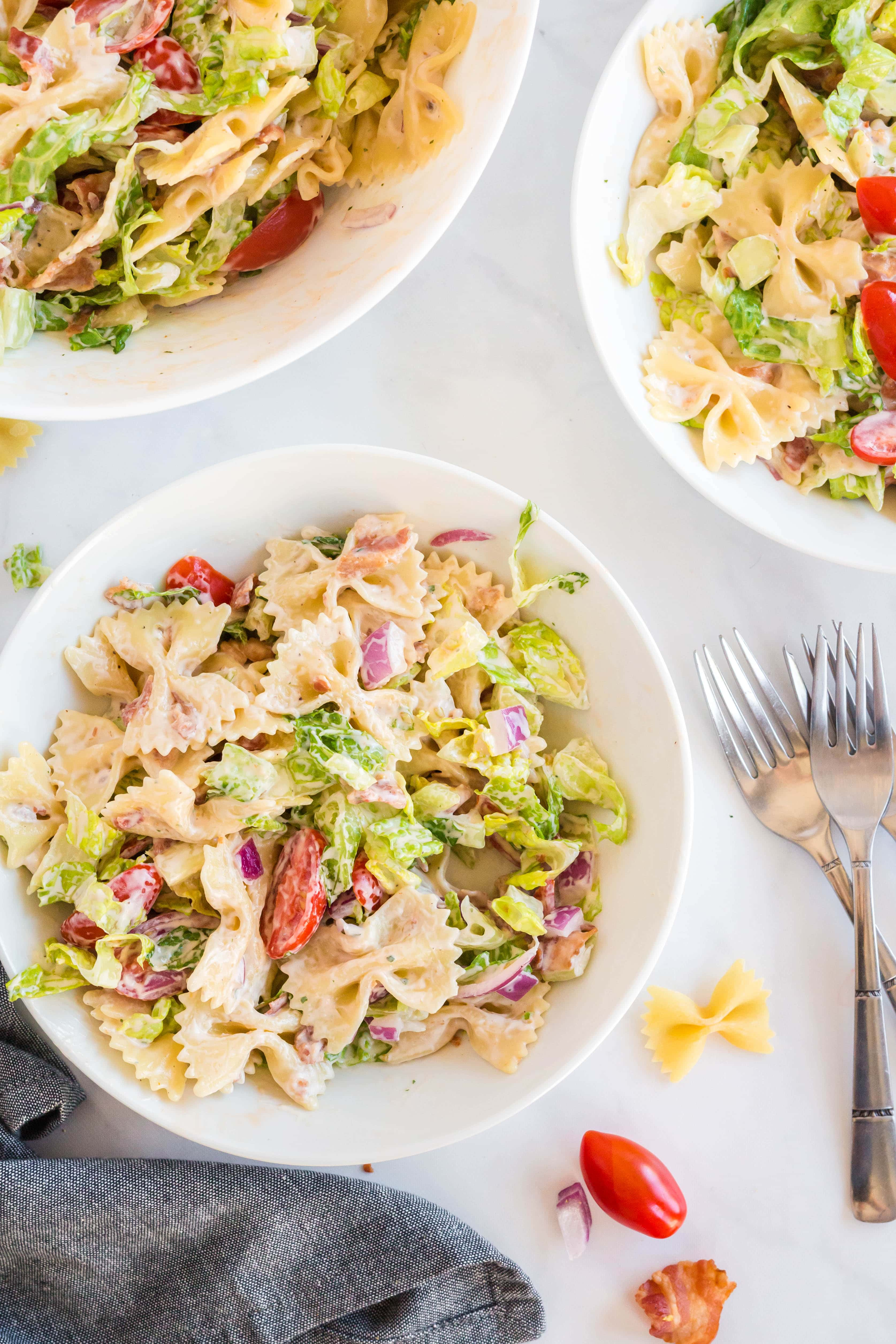 Multiple bowls of BLT pasta salad