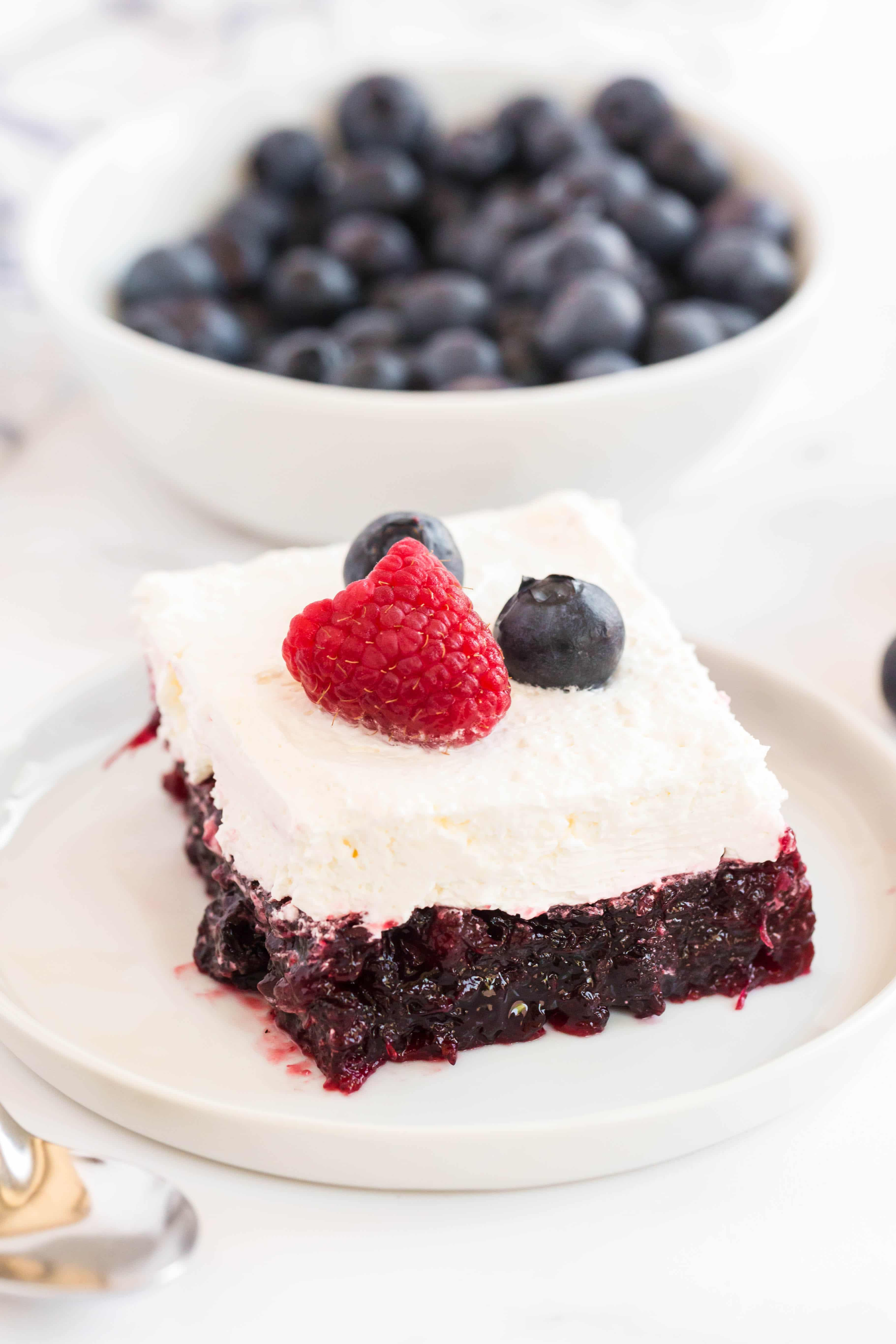 Blueberry Jello Salad is a classic layered dessert that is filled with delicious canned blueberries and topped with a delicious cream layer.