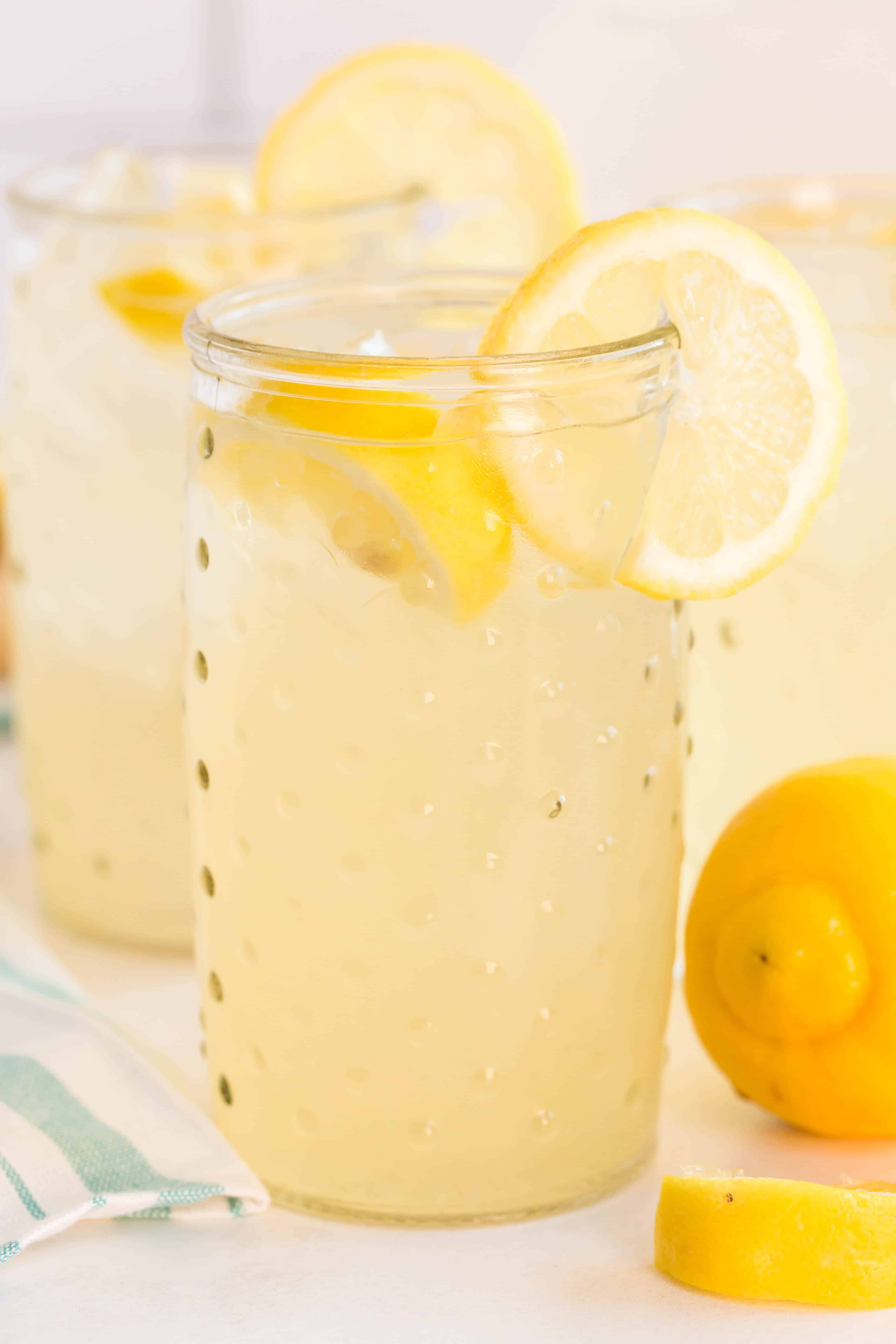 Homemade Lemonade is a refreshing summer drink recipe that is bursting with lemon flavor and sweetened to your likeness. Perfect for a hot summer day!