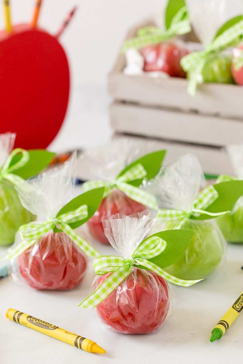 apple playdough wrapped in plastic and tied with green ribbon