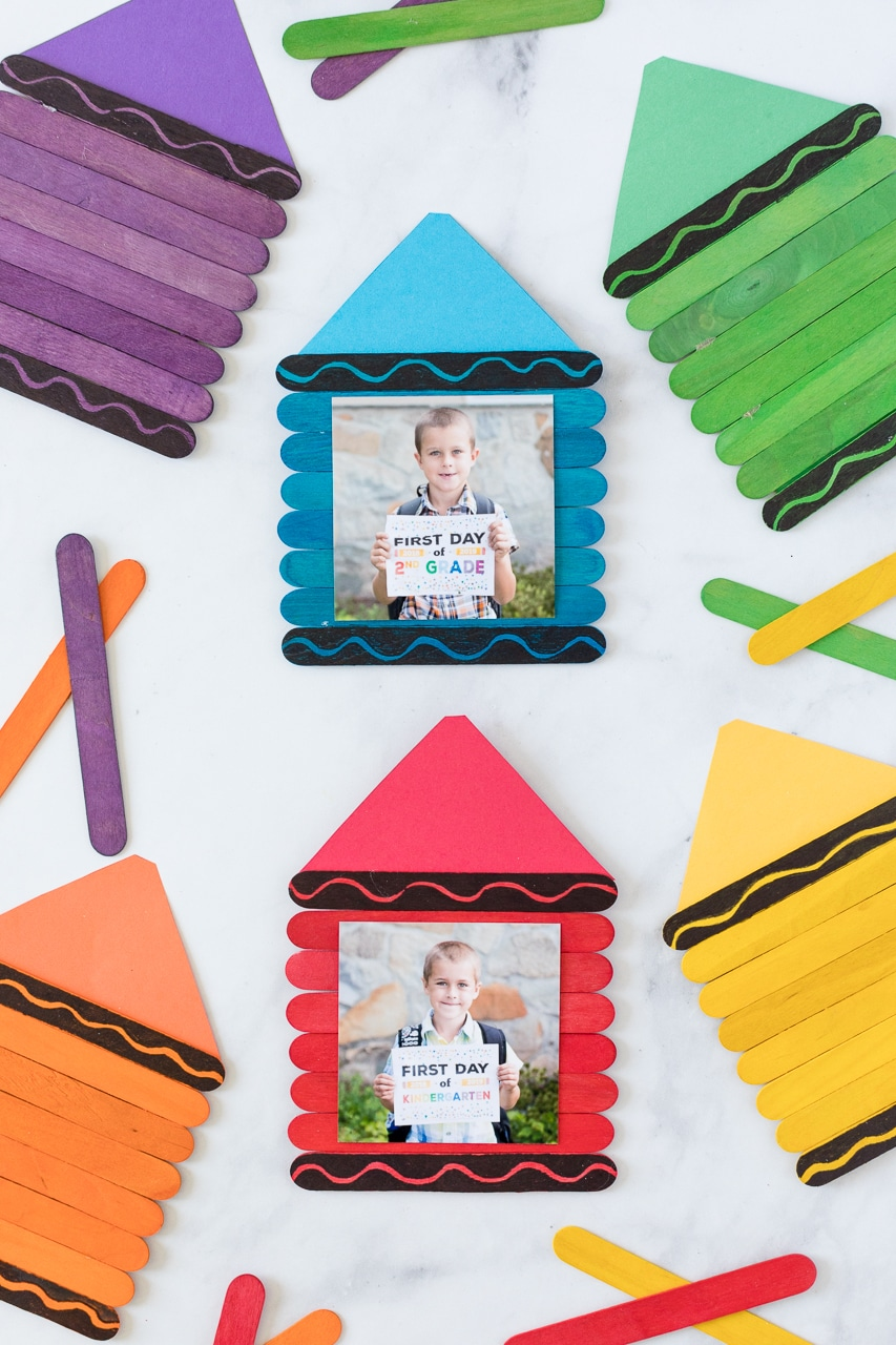 crayon photo frames on table with colored popsicle sticks