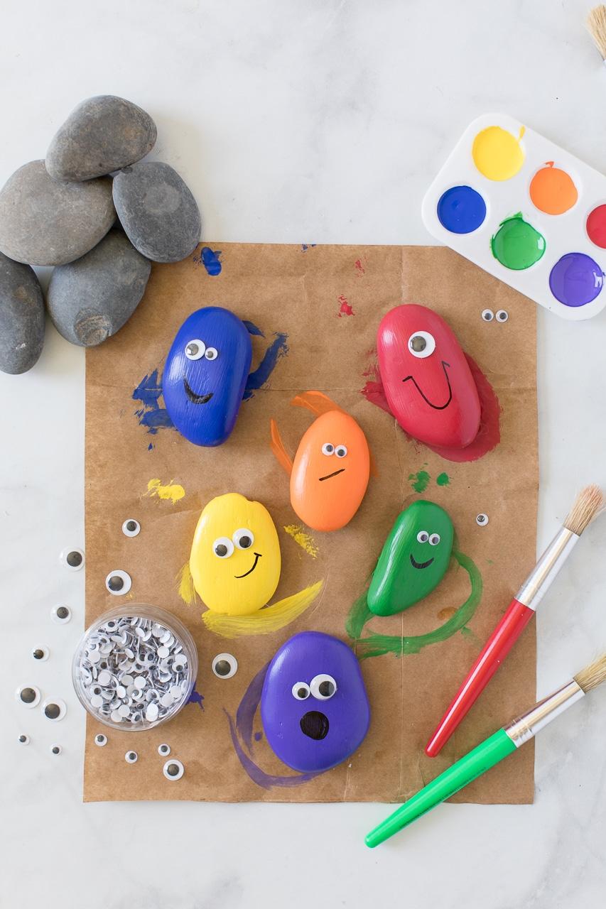 rainbow painted rocks on craft table